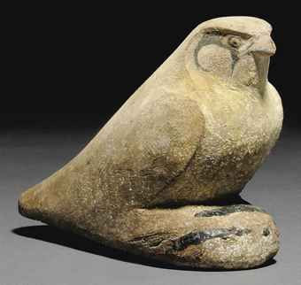 EGYPTIAN PAINTED WOOD FALCON  LATE PERIOD-PTOLEMAIC PERIOD, CIRCA 4TH-2ND CENTURY B.C.  With traces of yellow pigment on body, the facial markings, part of wing and forepart delineated in black, base with remains of dowel  5¼ in. (13.3 cm.) long