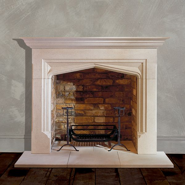 Tudor arch fireplace surround in limestone chesneys for Tudor style fireplace