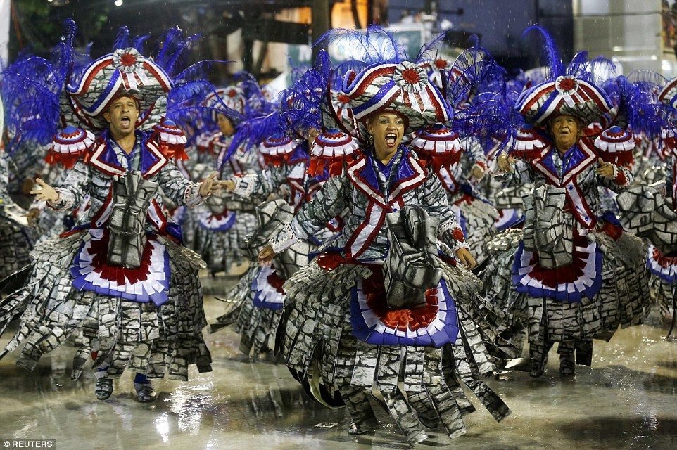 Members of the Mocidade Indepedente samba sing and dance in their own elaborate get up in ...