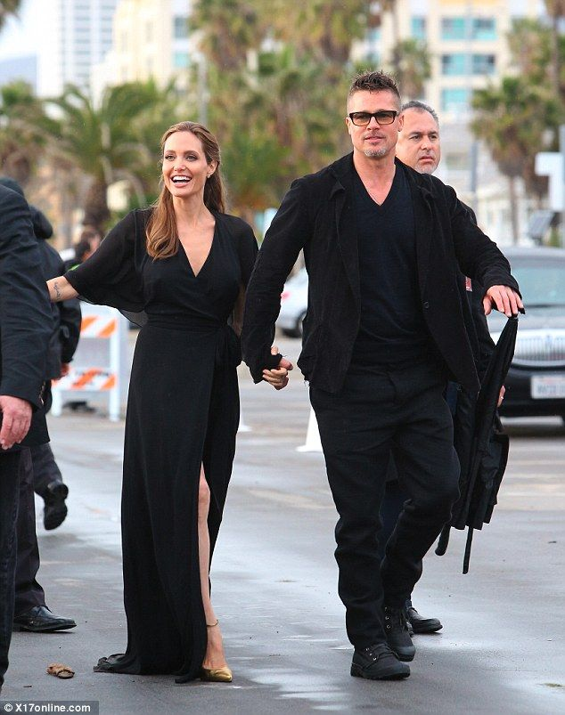 Hand in hand: Angelina and Brad looked happier as ever as they exited the award show