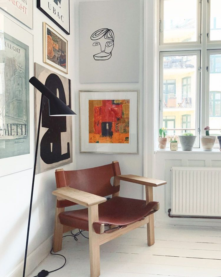 A White Danish Home Full Of Art and Scandinavian Design Classics