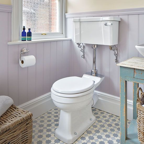period style bathroom with lilac painted panelling and patterned floor tiles