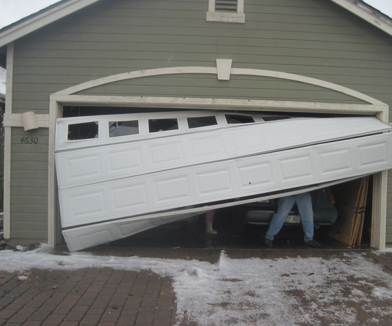 7 Ways To Fix A Dent In A Garage Door Panel Broken Garage Door Garage Door Panels Garage Door Installation