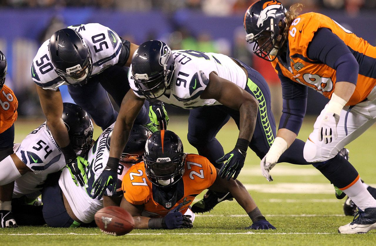 Denver Broncos running back Knowshon Moreno (27) fumbles the ball against the defense of the Seattle Seahawks during Super Bowl XLVIII at Metlife Stadium on Sunday, Feb. 2, 2014, in East Rutherford, N.J. The Denver Broncos were able to recover the fumble and keep possession of the ball.  (Todd Rosenberg/NFL)