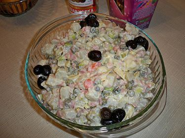 A homemade variant of the Olivier containing potatoes, peas, cabbage, sweet gherkins, capers, ham, carrots, olive oil, wine vinegar, dijon mustard, and sour cream, garnished with black olives. #olivierrussischersalat A homemade variant of the Olivier containing potatoes, peas, cabbage, sweet gherkins, capers, ham, carrots, olive oil, wine vinegar, dijon mustard, and sour cream, garnished with black olives. #olivierrussischersalat