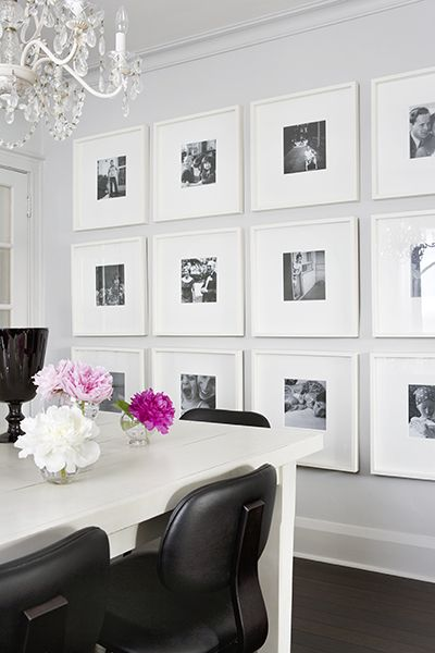 white frame all black and white pictures... wall in the dining room ...