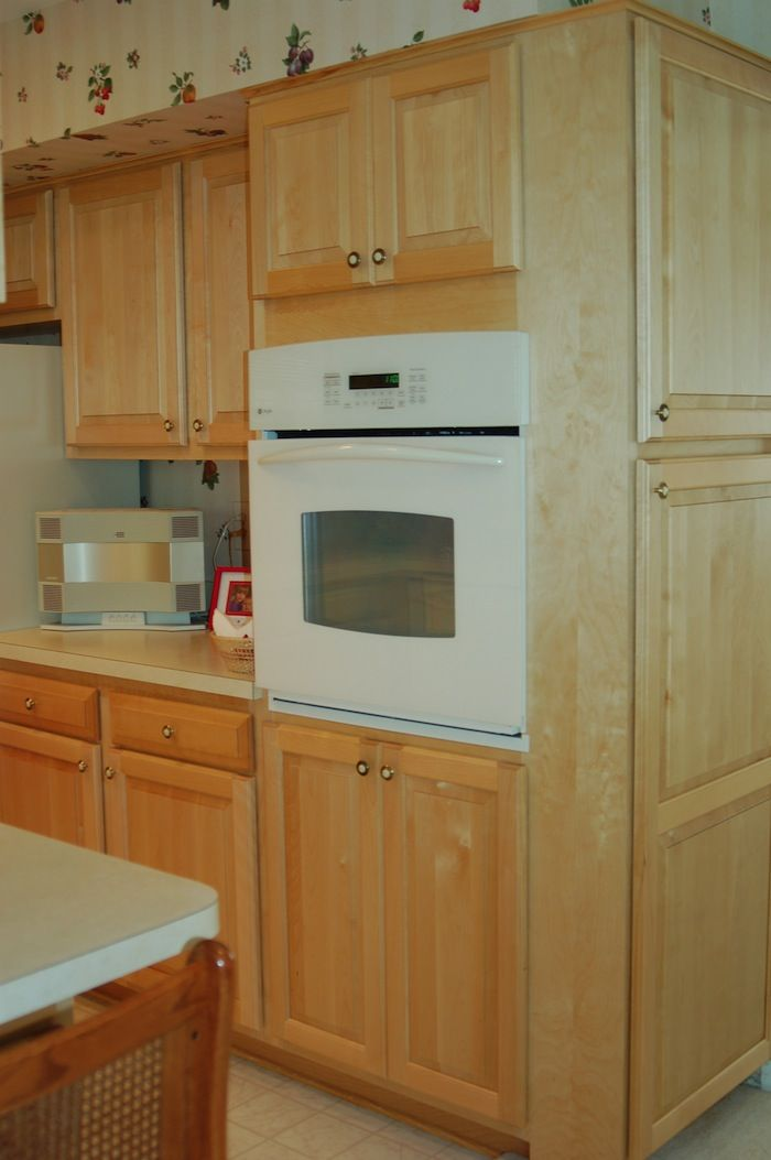 Newly refaced kitchen cabinets gives the space a more ...