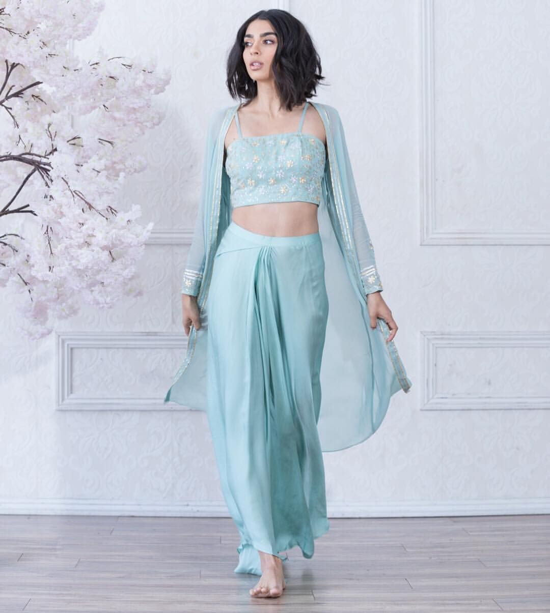 0770acf6c4 Long sleeves sheer cape paired with a dhoti skirt and crop top, can you say  Summer? The INAYAH outfit 💫 . . . #kynah #kynahgirl #lengha…