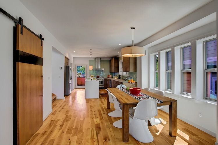 Inviting dining area - wooden flooring and sliding barn doors. Bright and open entertaining space!