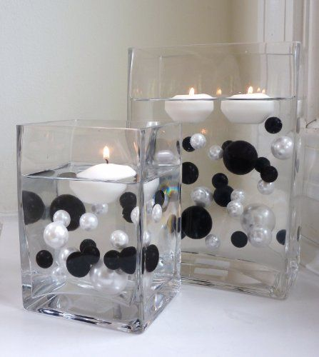 Pin By Trisha Anderson On Black And White White Centerpiece Floating Candles White Party