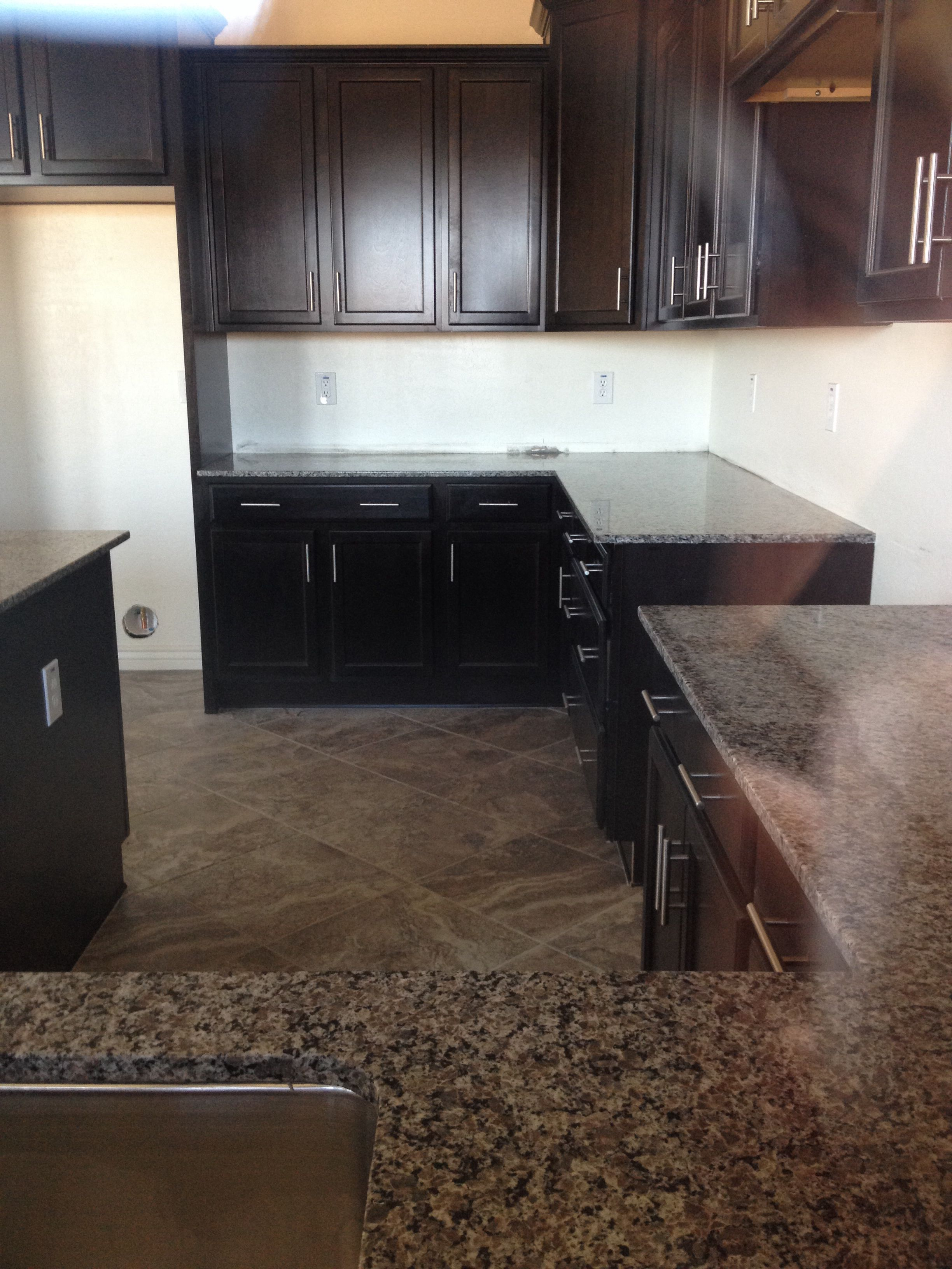 - New Caledonia Granite With Espresso Cabinets. A Peek Through The