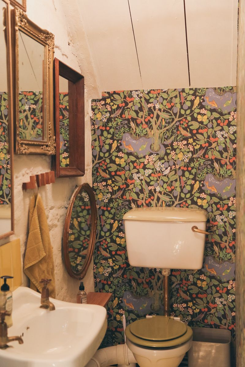 ⋴⍕ Boho Decor Bliss ⍕⋼ bright gypsy color hippie bohemian mixed pattern home decorating ideas - old bathroom with wallpaper and vintage art wall #downstairsloo