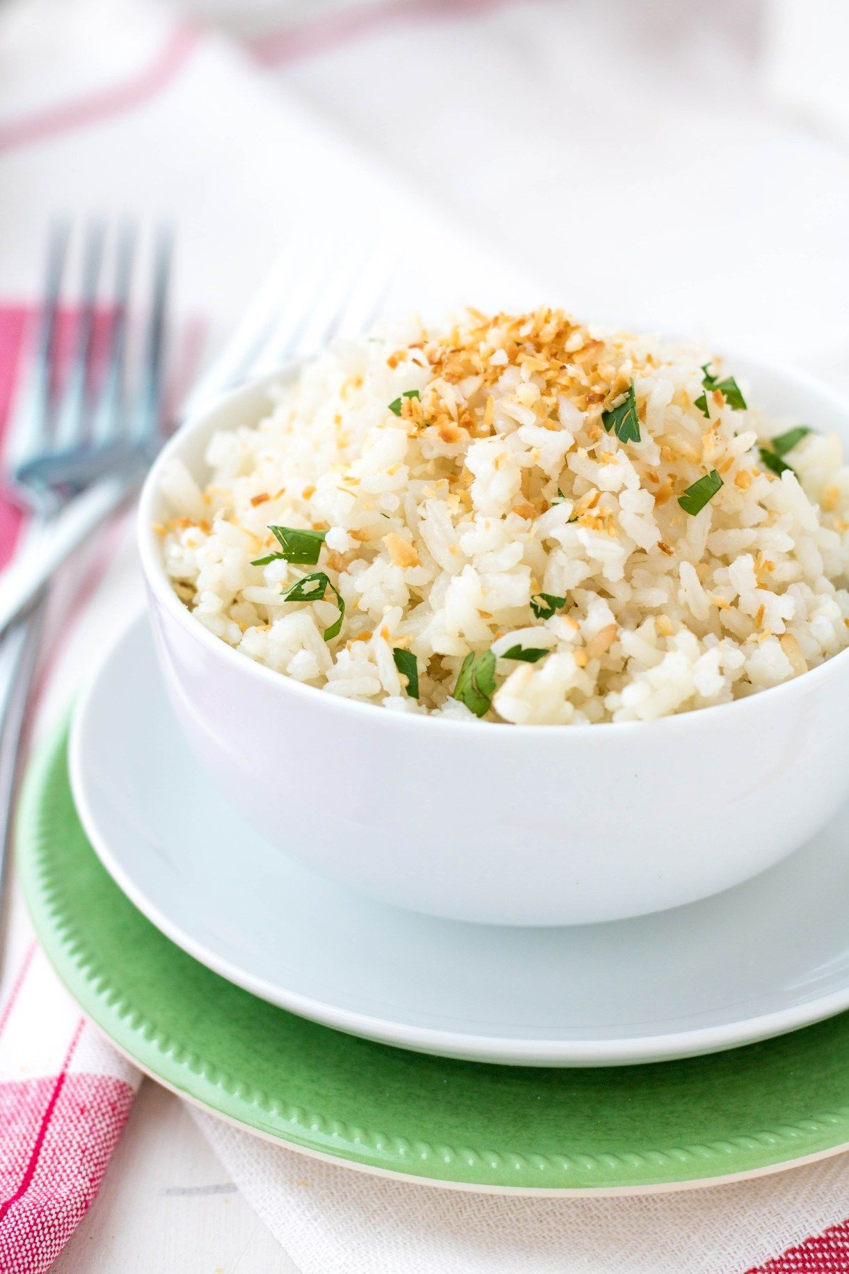 Coconut Jasmine Rice  Easy side dish of jasmine rice cooked in coconut milk and topped with toasted coconut  perfect with curry