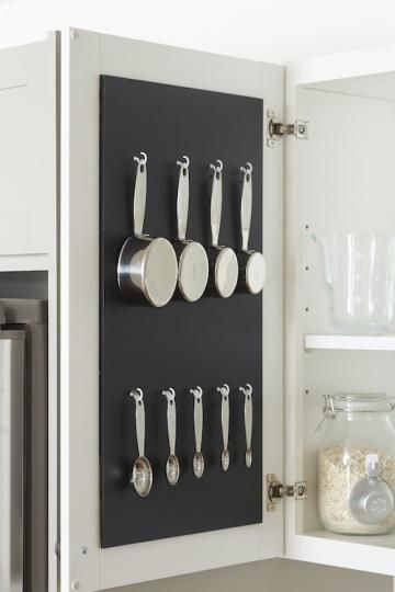 Organize and save space in the kitchen by hanging measuring cups and these do it yourself ideas will help you save space store and organize every room in the house solutioingenieria Image collections