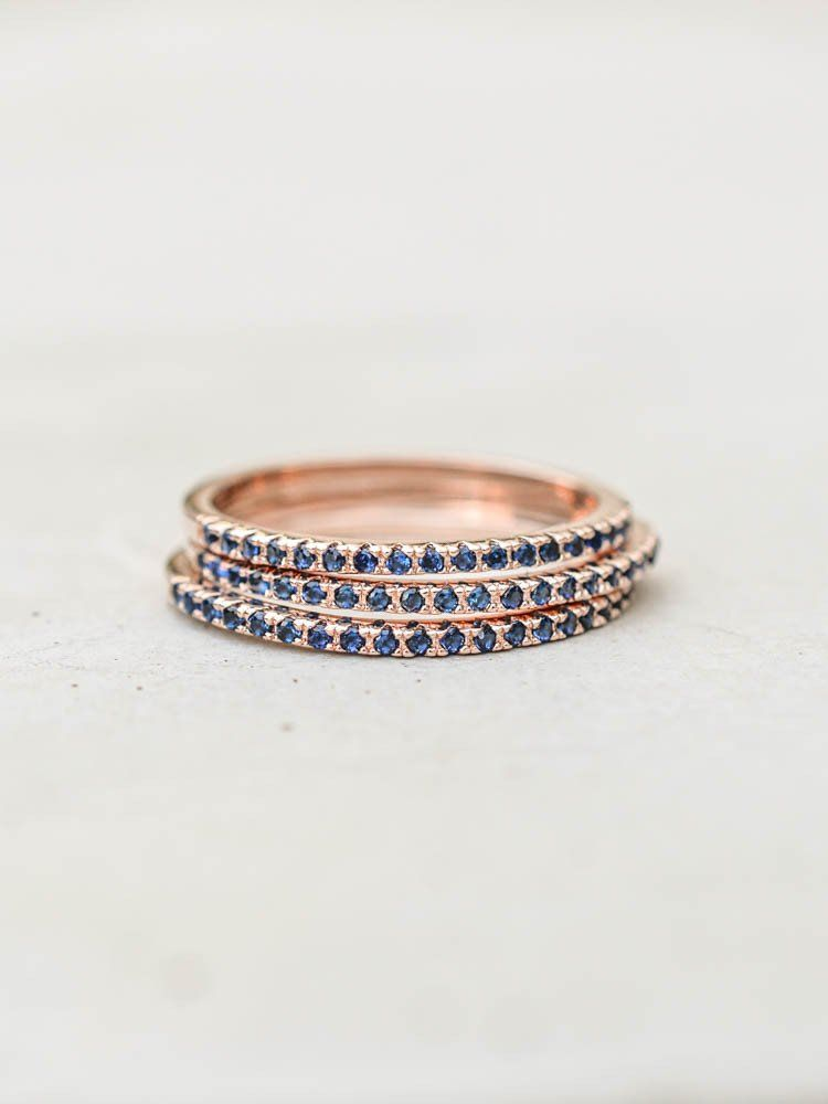 f7f19b3d0cab Eternity Ring Set - Rose Gold with Sapphire Blue Anillos De Compromiso
