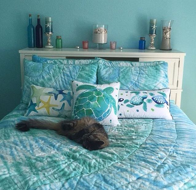 Want a calming bedroom? Try a soothing pallet of blues, as an ocean theme, and get sea turtle pillows/decor!