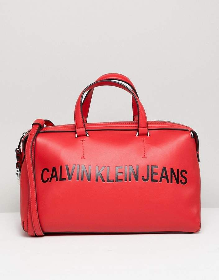 09dcc5325e8a Calvin Klein Jeans Sculpted Barrel Bag with Logo