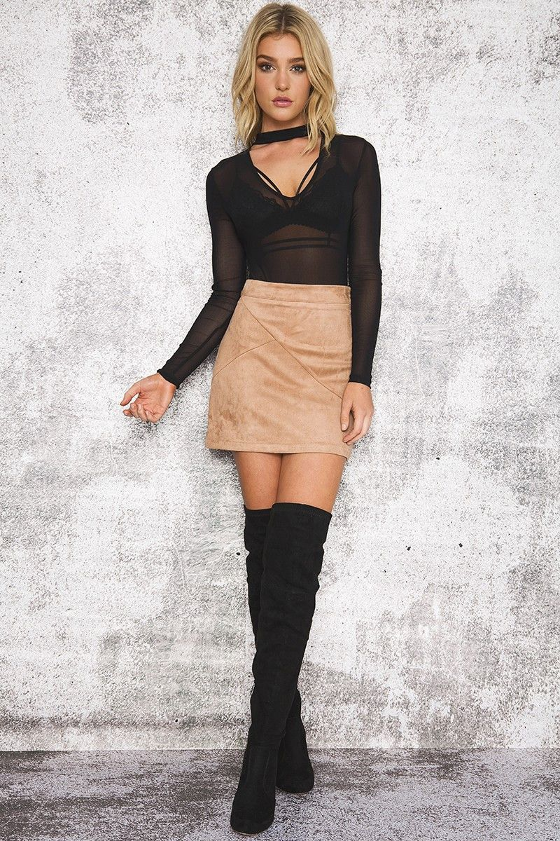 women in sexy knee boots and mini skirts