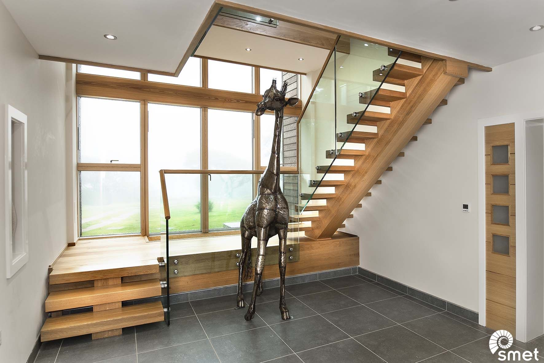 This solid French Oak staircase with intermediate landing