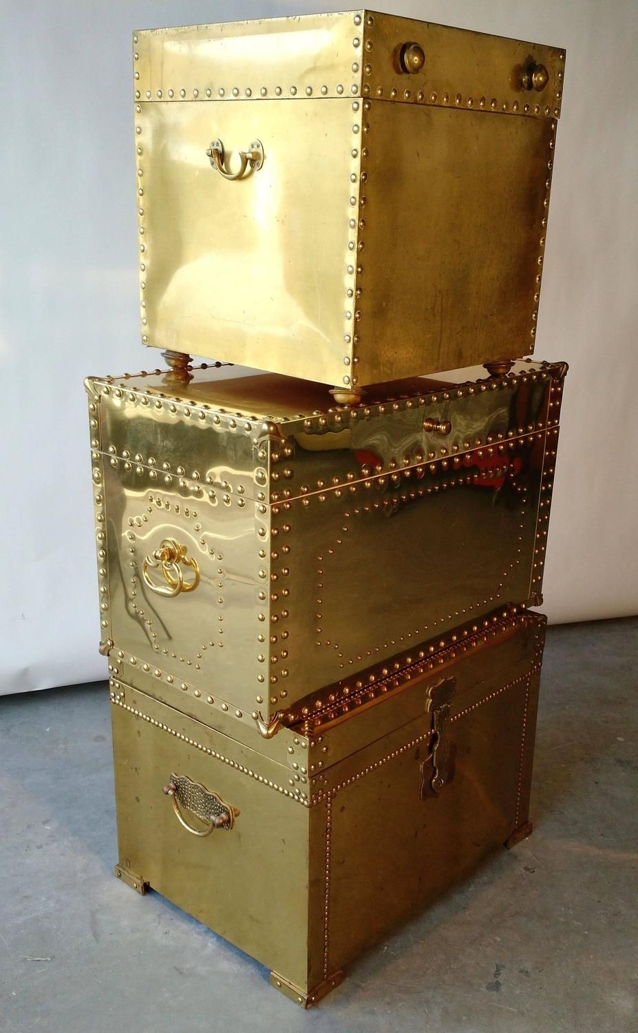 Collection of three vintage brass nailhead chests trunks hollywood for sale on whats better than a stack of vintage brass clad nailhead trunks could be lined up and used as a coffee table or side tables geotapseo Gallery