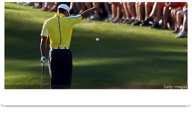 tiger woods drop after his ball bounced off the flag stick