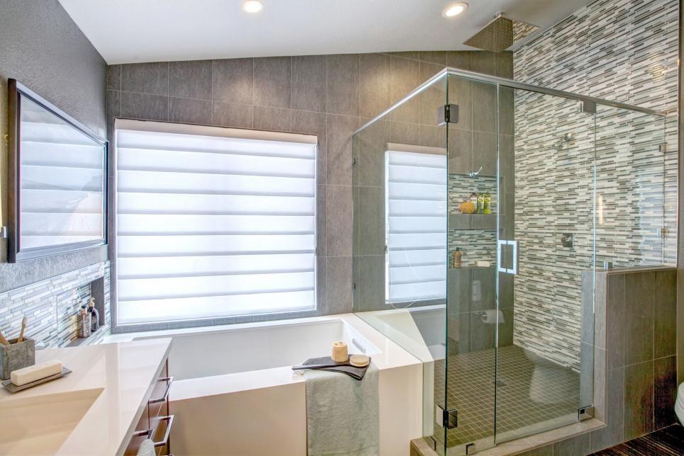 A large soaking tub tucks up against this bathroom\'s corner walk-in ...
