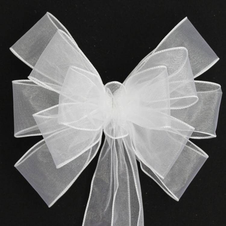 "This white sheer wedding bow is created with a 2.5"" white sheer wire edge. This bow is the perfect bow to hang on pews in a church or to use a chair bows at the receptions. Bow Details: - 13 loops of"