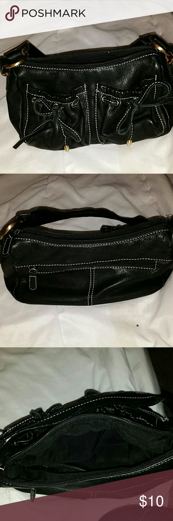 Leather purse by Wilson Great little leather purse.  Inside is clean. Only flaw was a small hole on the inside zipper pocket. Wilsons Leather Bags