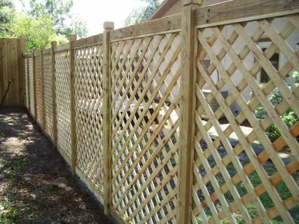 installing lattice fences in your yard in 2020 lattice on inexpensive way to build a wood privacy fence diy guide for 2020 id=95039