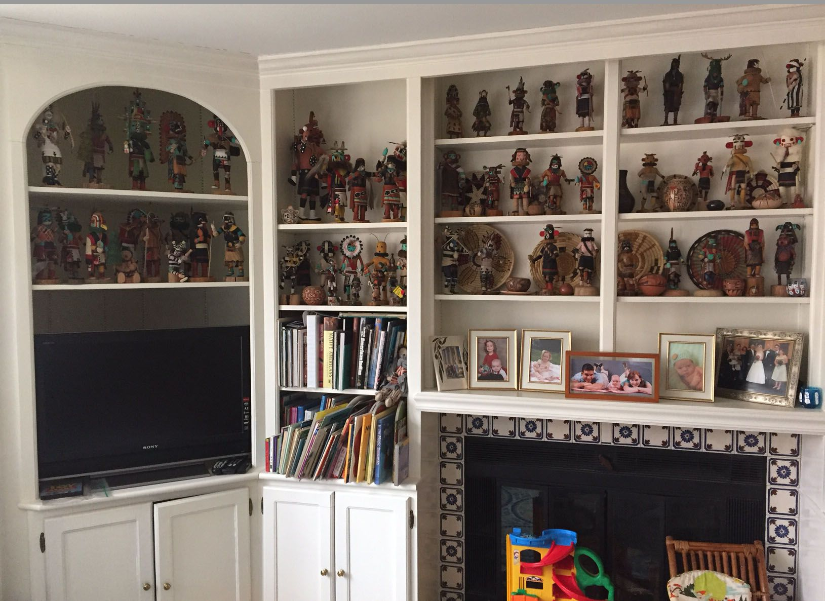 Kachina Doll and Basket Collection on shelving in den.