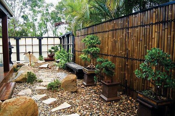 japanese style garden bamboo fence plants on pedestal rock ground cover large rocks - Garden Ideas Japanese