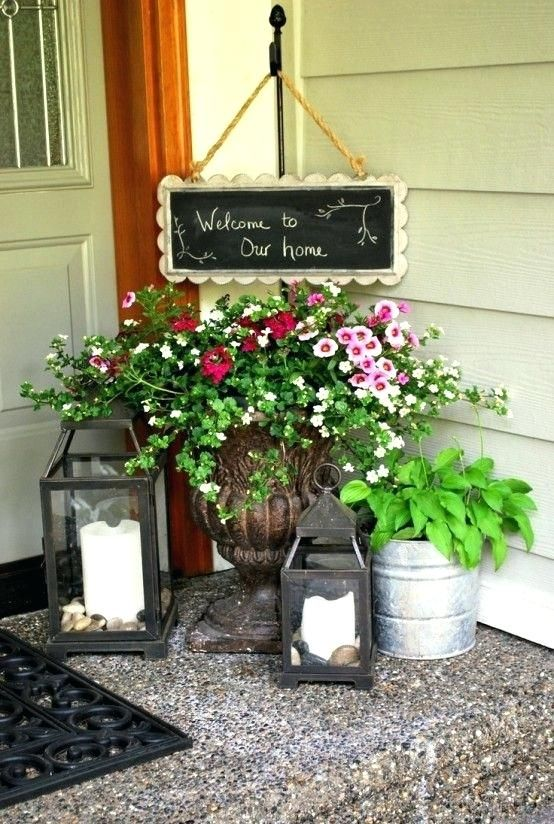Front Porch Planter Ideas Candle Lanterns And Planters With Greenery And Flowers Is All You Need To Re Front Porch Decorating Porch Decorating Door Decorations