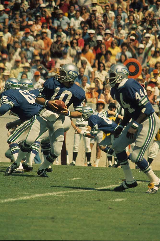 4b8dfbf26b0 Quarterback Jim Zorn  10 of the Seattle Seahawks drops back to pass in an  NFL game against the Tampa Bay Buccaneers at Tampa Stadium on October 17