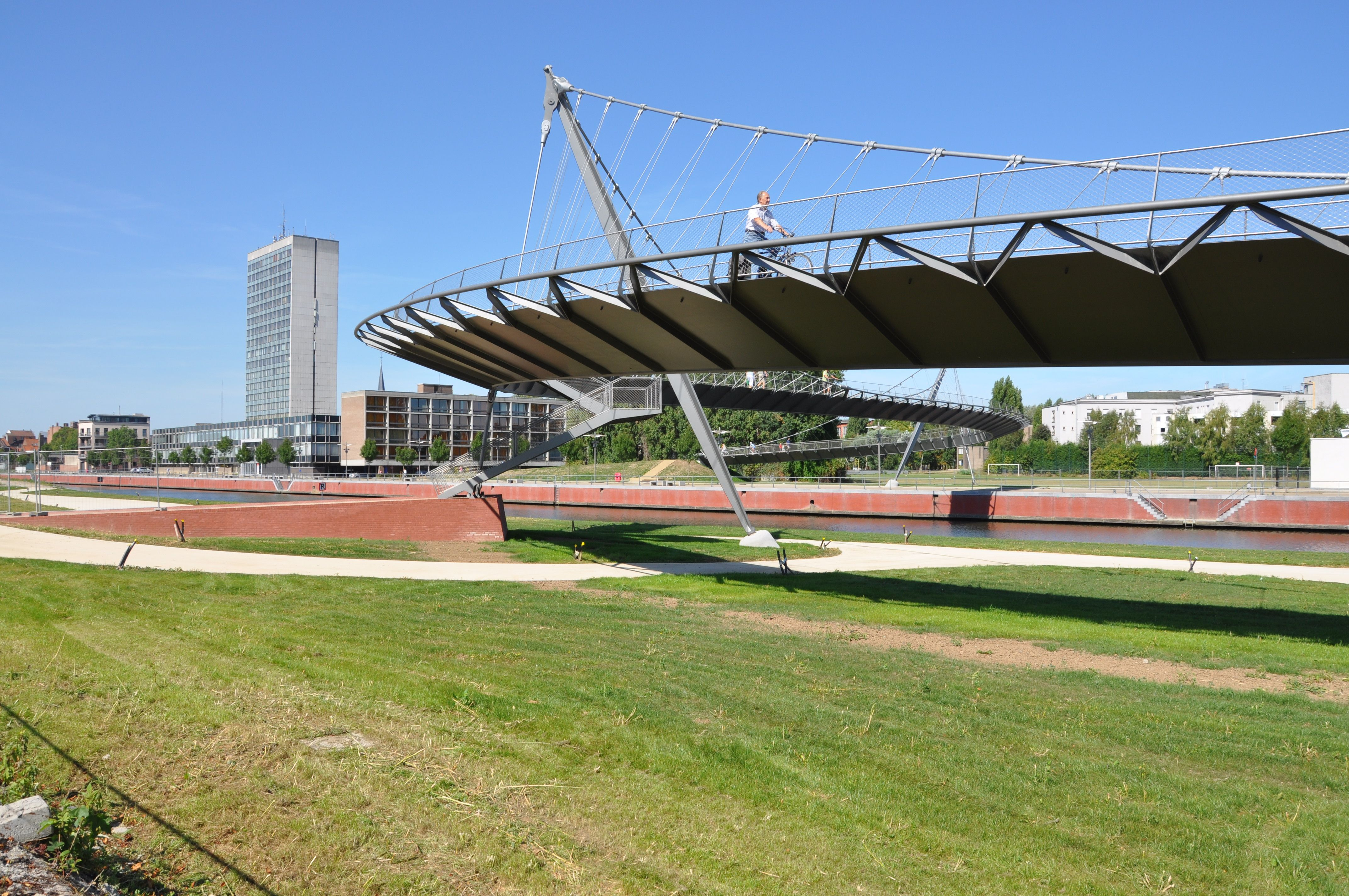 7 bridges overspan the leie river in the heart of kortrijk. the