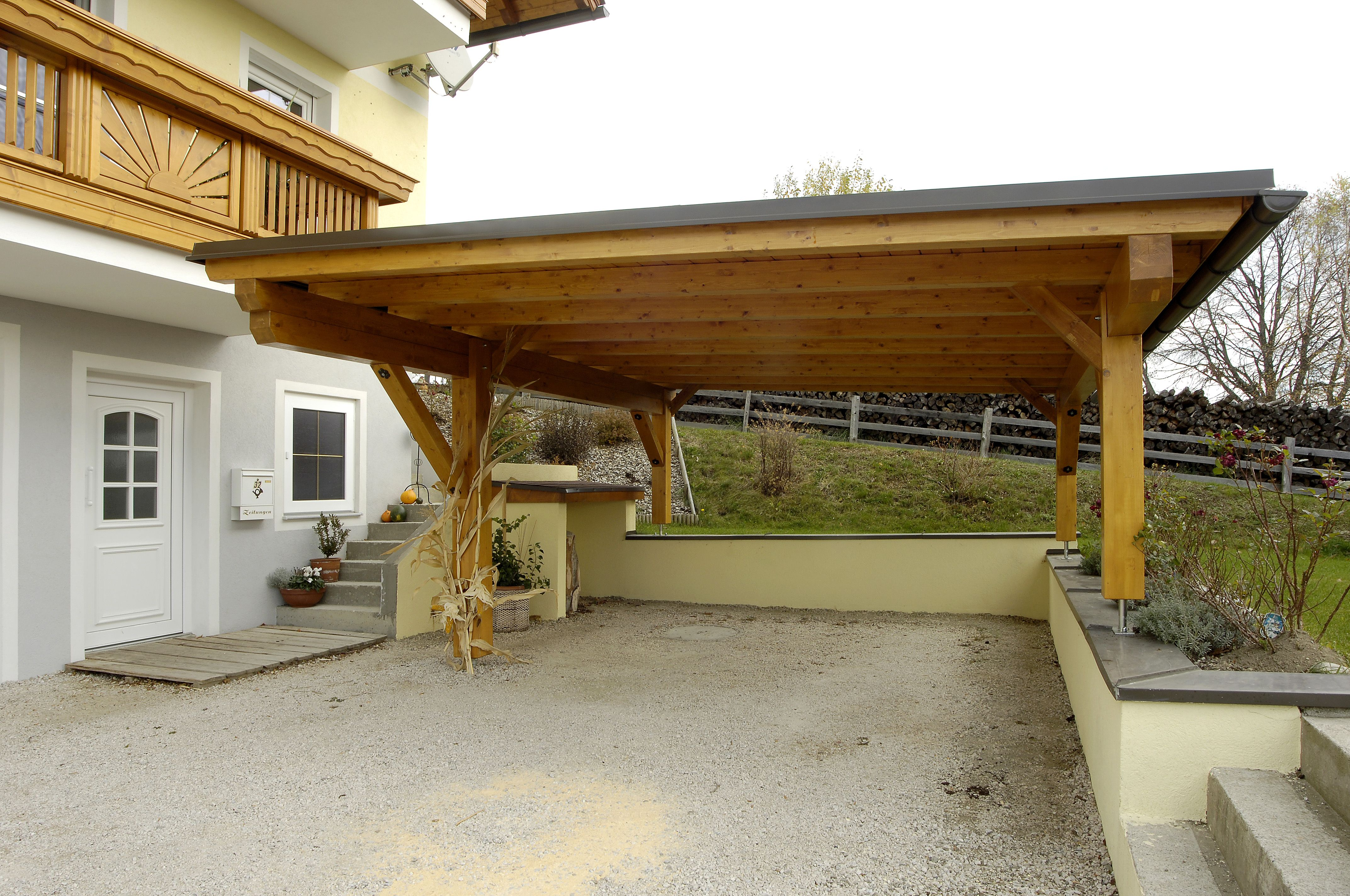 The frame of this carport is a wooden material that cover