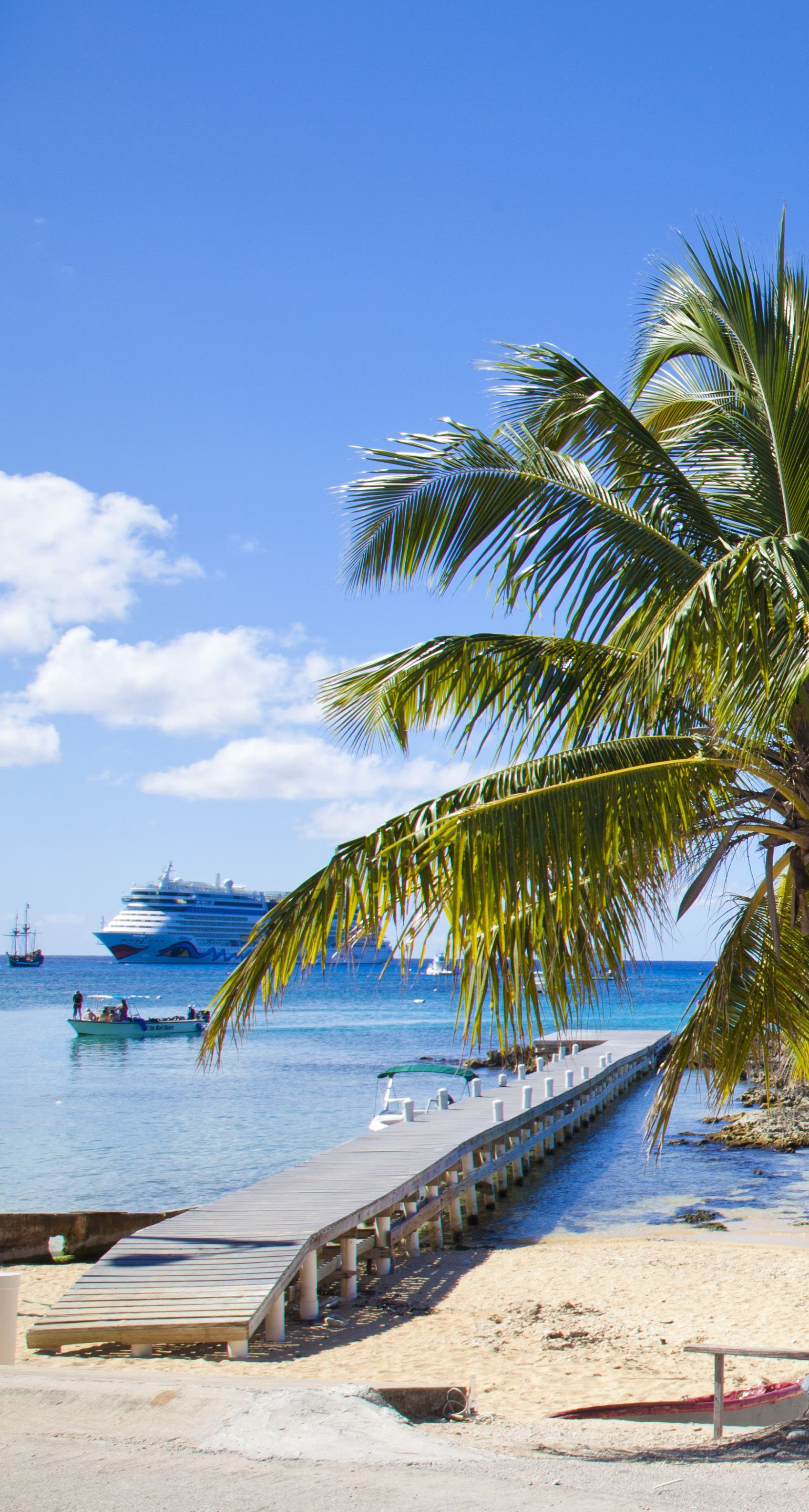 Fishing Dock in Grand Cayman and cruise ship in the horizon