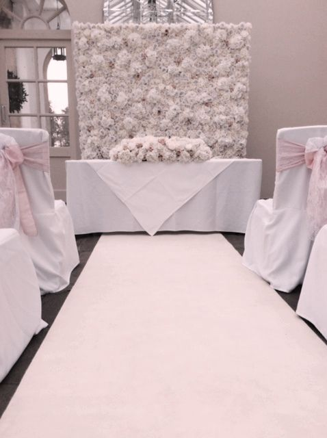 wedding chair cover hire brighton low profile folding flowerwall backdrop from pollen4hire decorated by pollen flowers of covers with white vintage lace and pale pink taffeta tied together to