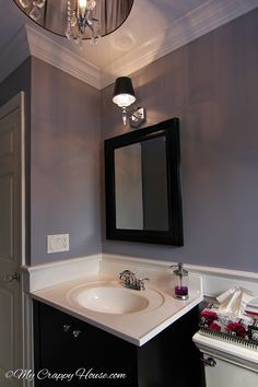 love this bathroom, perfect shade of light gray/lavender (Excalibur Gray by Benjamin Moore) with the black mirror and sink vanity (from mycrappyhouse.com)