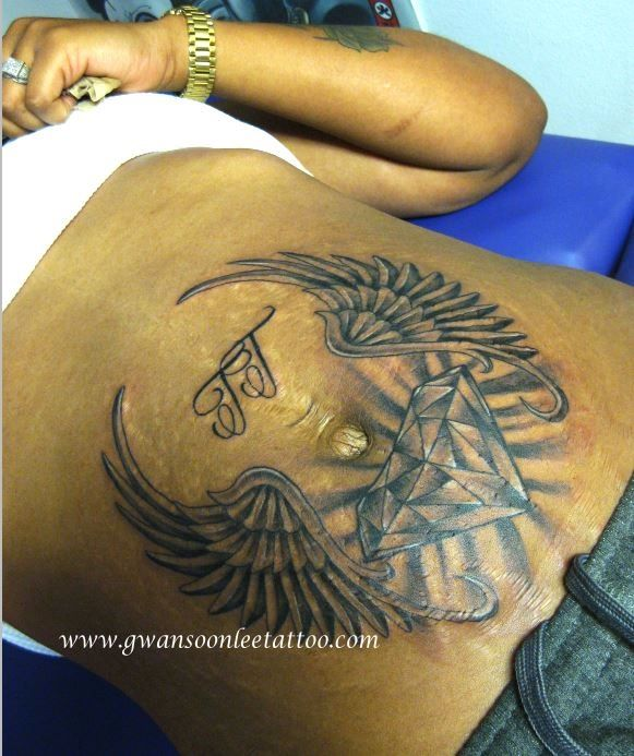 diamond and angel wings tattoo design stomach