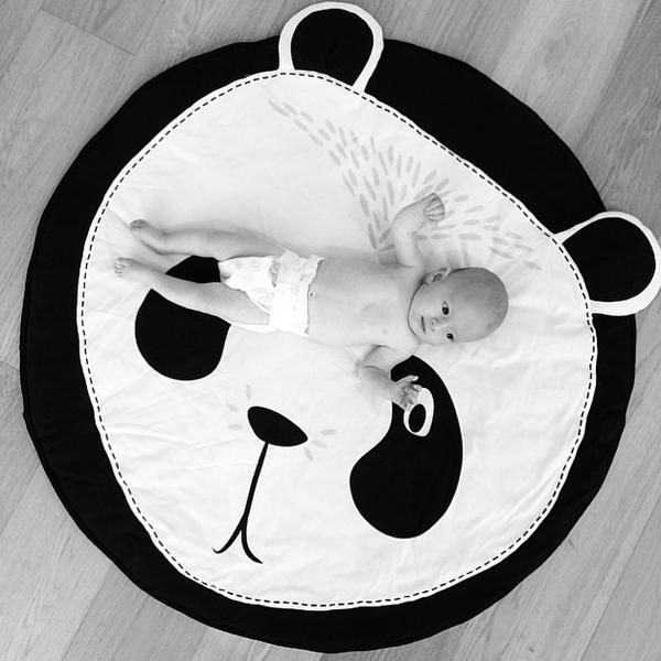 Black and white baby play mat in panda face animal print
