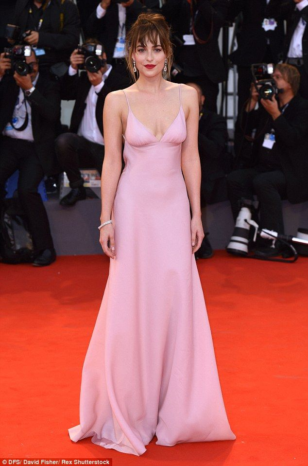 Dakota Johnson shows cleavage flesh-tone gown on Venice Film Festival red  carpet  7c2deb892426