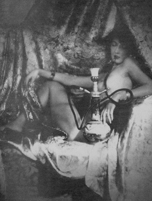 Vintage hooker with a hookah?