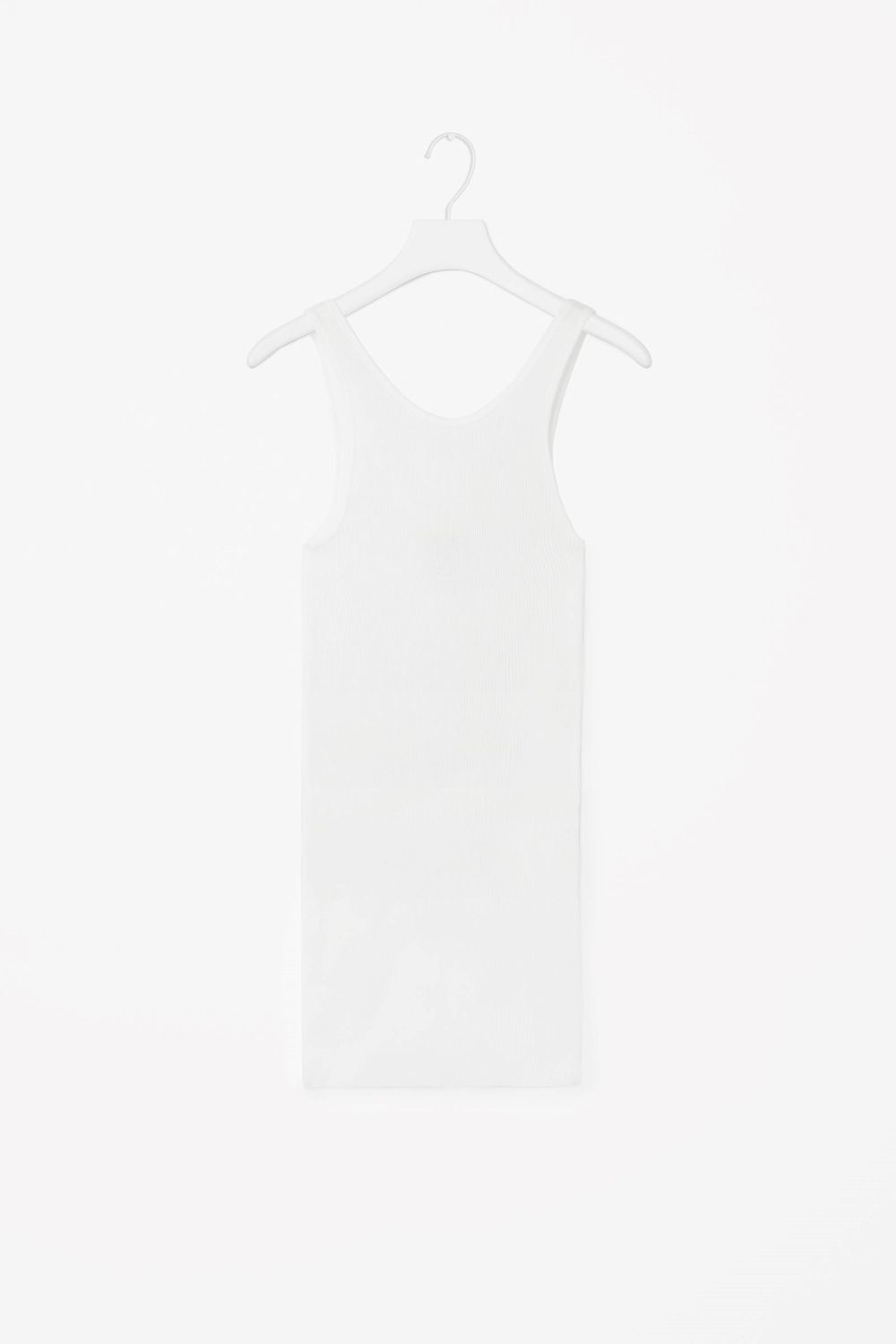 This long vest top is made from a soft jersey cotton with a ribbed quality. A close-fit, it has a round neckline, deep back and a minimal hemline finish.