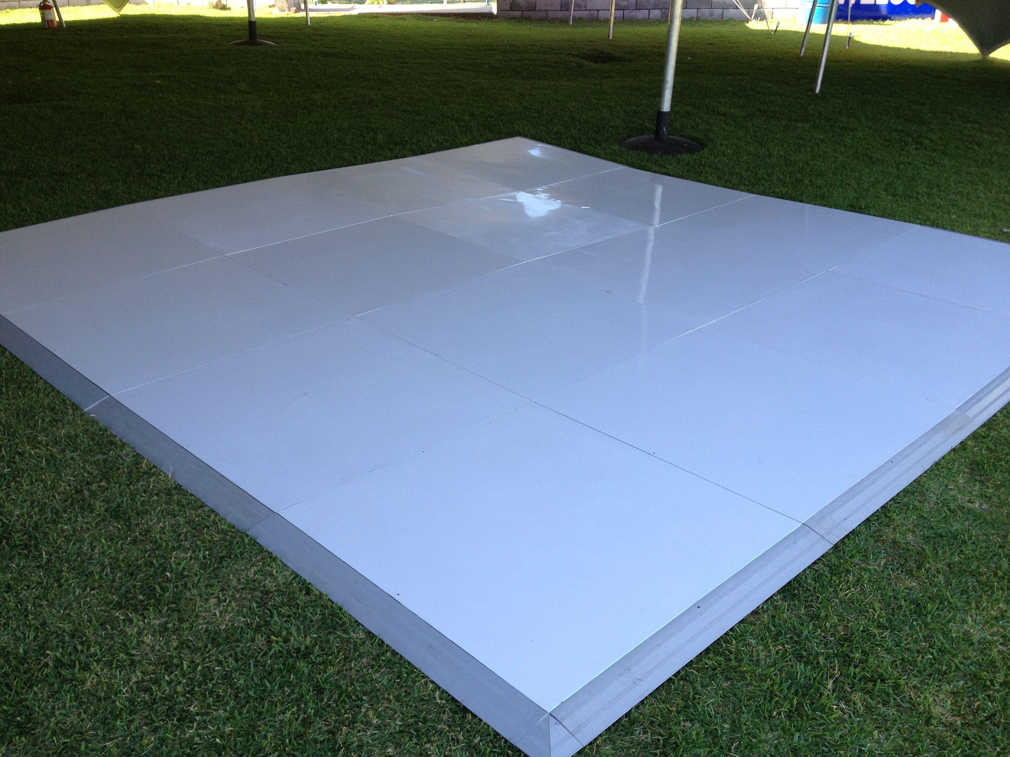 dance floor on grass under a marquee | Vinyl wrapped floor panels ...