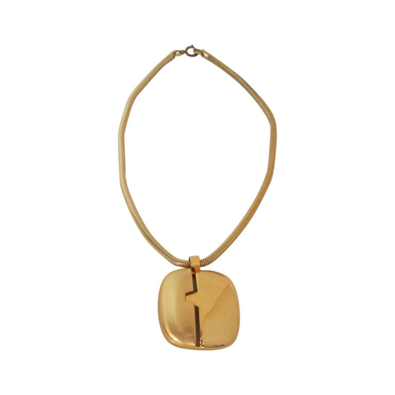 1970s Lanvin gold modernist pendant necklace   From a unique collection of vintage drop necklaces at http://www.1stdibs.com/jewelry/necklaces/drop-necklaces/