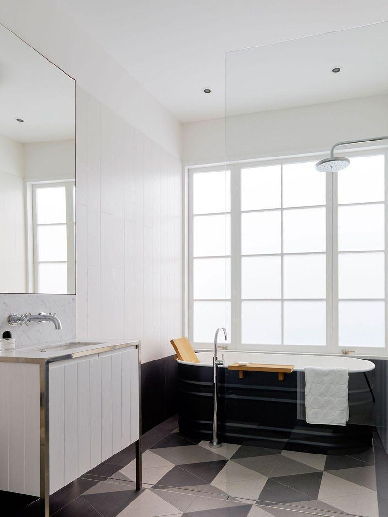 In this bathroom a steel bath sits on an escher inspired tile in this bathroom a steel bath sits on an escher inspired tile pattern it dailygadgetfo Gallery