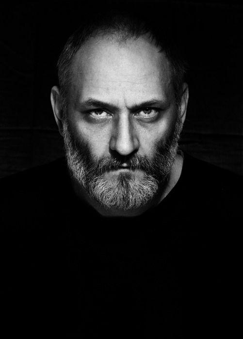 Stare of a man portrait model man black white eyes black beard face stare