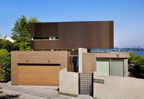 modern cedar horizontal wood siding home with dark shingles and