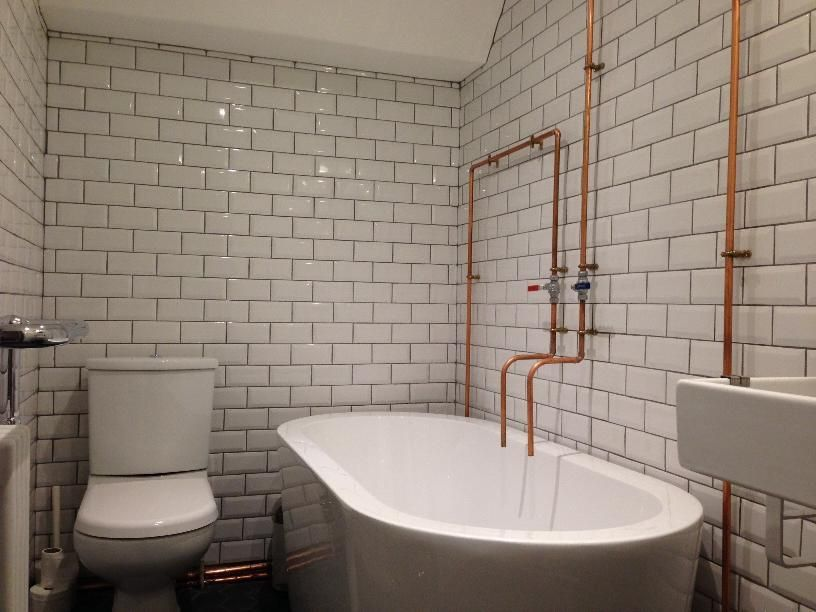 The Art Gallery Richard from London created a cool industiral theme in his bathroom with copper pipes and white