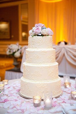 #White #lace wedding #cake with #pink flowers (Photo by Emily Steffen)